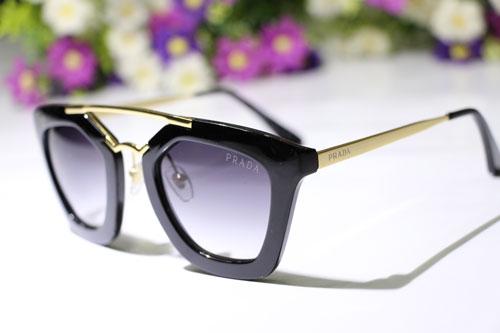 خرید عینک آفتابی میو میو